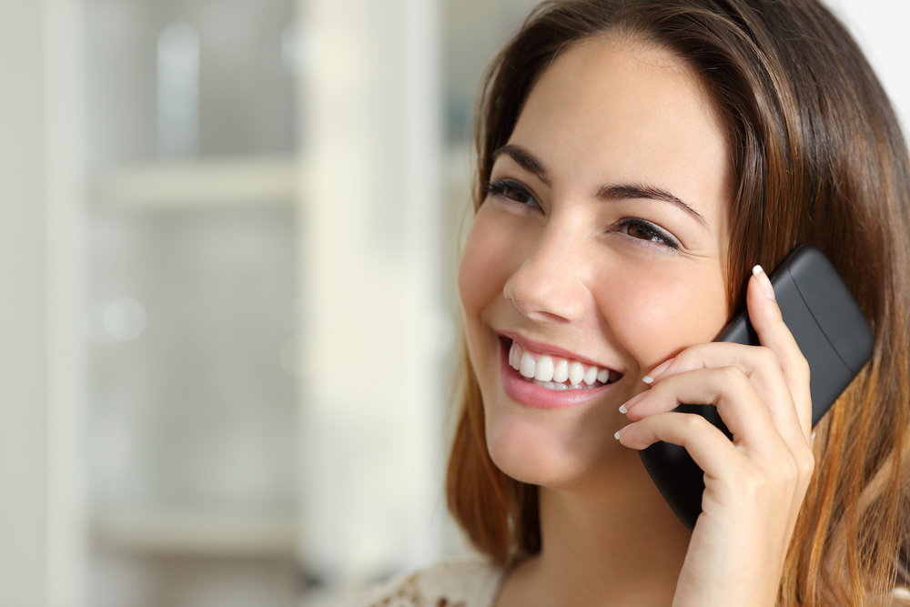 Woman Talking On The Mobile Phone At Home